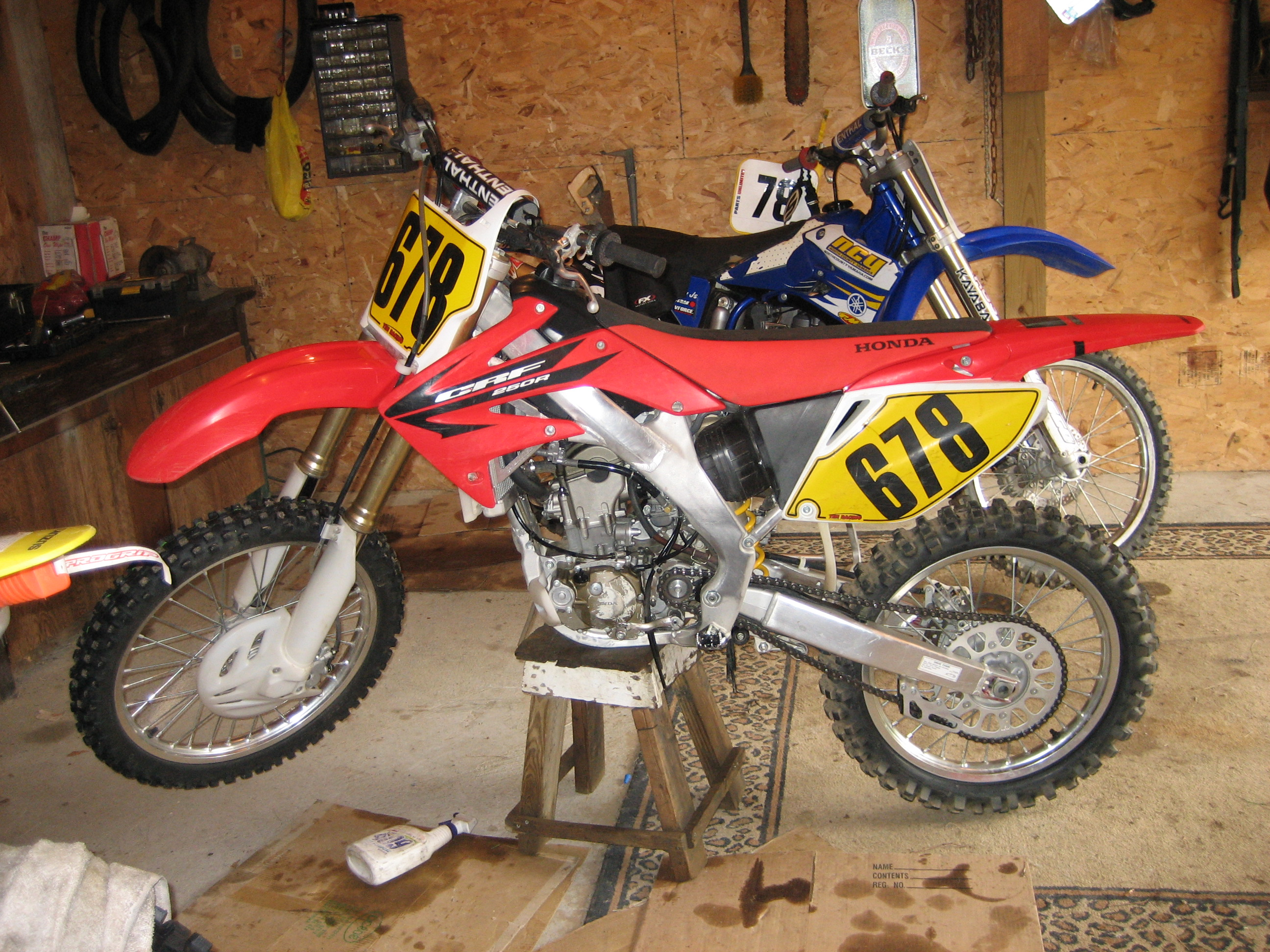 Build a dirt bike stands pictures to pin on pinterest for How to make a bike stand out of wood
