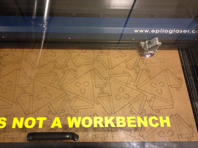 Epilogue laser cutter in action.
